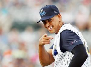 New York Yankees' Alex Rodriguez points towards a fan before the start of a Class AA baseball game with the Trenton Thunder against the Reading Phillies.