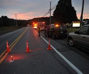 Emergency crews respond to a reported shooting at the Ross Township building that left three people dead, Monday, Aug. 5, 2013 in Saylorsburg, Pa.