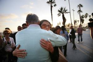 Alice Gruppioni's aunt and father-in-law comfort each other near a makeshift memorial for Gruppioni on Ocean Front Walk at Venice Beach.