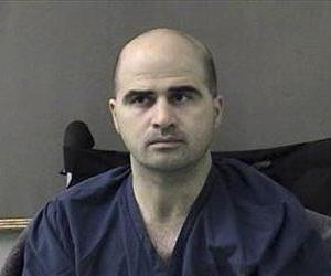 This April 9, 2010 file photo shows Nidal Hasan at the San Antonio to Bell County Jail in Belton, Texas, after the Nov. 5 shooting spree at Fort Hood.