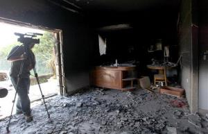 This Sept. 13, 2012 file photo shows a cameraman filming one of  US consulate burnt out offices in Benghazi, Libya.