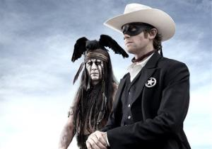 This publicity image released by Disney shows Johnny Depp as Tonto, left, and Armie Hammer as The Lone Ranger.