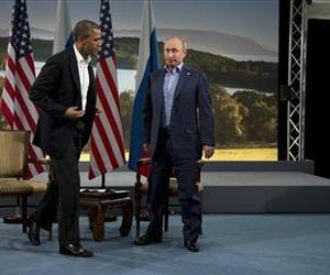 In this June 17, 2013 file photo, President Barack Obama and Russian President Vladimir Putin get up to leave after their meeting in Enniskillen, Northern Ireland.