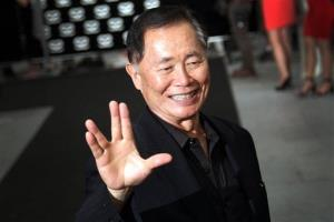 American actor George Takei gestures with a hand greeting made popular by the Television series Star Trek arrives at the Marina Bay Sands hotel on Thursday, May 23, 2013 in Singapore.