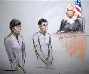 This courtroom sketch shows defendants Dias Kadyrbayev, left, and Azamat Tazhayakov appearing in front of Federal Magistrate Marianne Bowler at the Moakley Federal Courthouse in Boston, May 1, 2013.