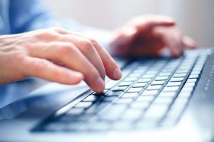 A man typing away.