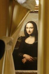 A painting attributed to Leonardo da Vinci and representing Mona Lisa is seen during a preview presentation in a vault in Onex near Geneva, Wednesday, September 26, 2012.