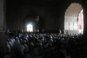 Pakistani Muslims offer prayers at Badshahi mosque on the last Friday of the Muslim holy month of Ramadan in Lahore, Pakistan, Friday, Aug. 2, 2013.