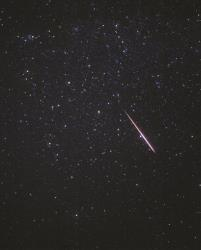 A Perseid meteor flashes across the constellation Andromeda on Aug. 12, 1997, in this 8-minute exposure taken in Florence Junction, Ariz.