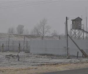A watch tower and barracks of a prison camp, similar to one in Partsa, is  seen in the village of Barashevo, some 370 km (230 miles) east of Moscow, Russia, on Friday, Nov. 2, 2012.