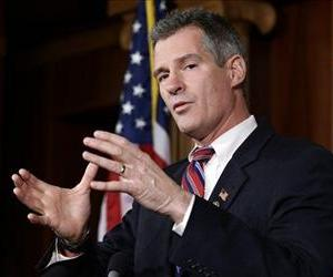 In this Nov. 13, 2012 file photo, Sen. Scott Brown, R-Mass., speaks during a media availability, on Capitol Hill.