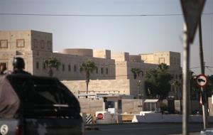 A Jordanian military vehicle drives around the U.S. embassy in Amman, Jordan, Tuesday, Aug. 6, 2013, one of 19 American diplomatic posts ordered closed following terror threats.