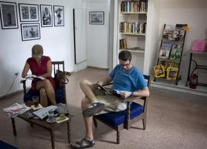 Customers read at the English-language Cuba Libro in Havana.