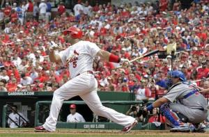 Former St. Louis Cardinals first baseman Albert Pujols following through on a solo home run.