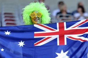 A soccer fan holds an Australian flag before the quarterfinal between Sweden and Australia at the Women's Soccer World Cup in Augsburg, Germany, on July 10, 2011.