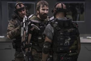 Columbia Pictures-Sony shows Sharlto Copley, center, in a scene from Elysium.