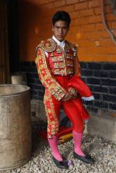 Bullfighter Brayan Quinonez poses for a portrait before his performance at the Yawar Toro center during a festival on the outskirts of Lima, Peru.