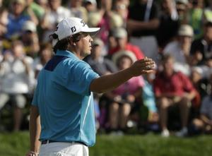 Jason Dufner reacts after missing a birdie putt on the 12th hole during the final round of the PGA Championship golf tournament at Oak Hill Country Club, Sunday, Aug. 11, 2013, in Pittsford, NY.