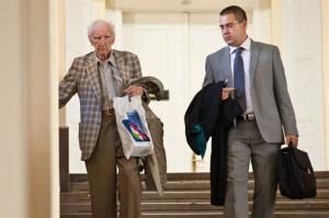 Alleged Hungarian war criminal Laszlo Csatary, left, is flanked by his lawyer Gabor Horvath as he leaves the Budapest Prosecutor's Office Wednesday, July 18, 2012.