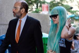 In this Tuesday, July 9, 2013 file photo, Amanda Bynes, accompanied by attorney Gerald Shargel, arrives for a court appearance in New York.