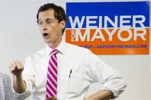 New York City mayoral candidate Anthony Weiner talks to voters in the Queens borough of New York.