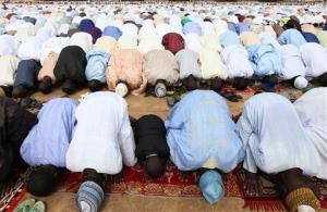 Nigeria muslims offer their prayers during Eid al-Fitr at Ramat square in Maiduguri, Nigeria.