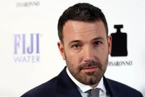 Ben Affleck arrives at the premiere of To The Wonder hosted by FIJI Water on Tuesday, April 9, 2013 in Los Angeles.