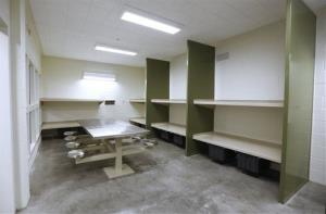 In this Feb. 21, 2013 file photo,  a multi-inmate cell is seen at a new housing unit near completion at the Madera County Jail  in Madera, Calif.