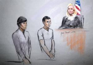 This courtroom sketch of May 1, 2013 by artist Jane Flavell Collins shows defendants Dias Kadyrbayev, left, and Azamat Tazhayakov appearing at the Moakley Federal Courthouse in Boston.