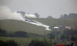 A UPS cargo plane lies on a hill near Birmingham Shuttlesworth International Airport.