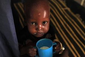 A young Somali boy being treated for malnutrition drinks therapeutic milk at a Doctors Without Borders hospital in Kenya.