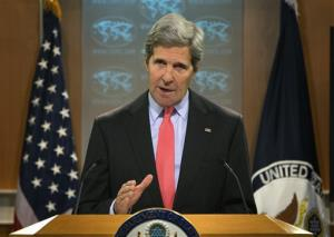 Secretary of State John Kerry gestures during a statement on the ongoing situation in Egypt before the start of a press briefing at the State Department in Washington, Wednesday, Aug. 14, 2013.