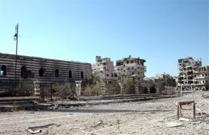 This Saturday, July 27, 2013 photo shows the Khalid Ibn al-Walid Mosque in the heavily disputed northern neighborhood of Khaldiyeh, in Homs, Syria.