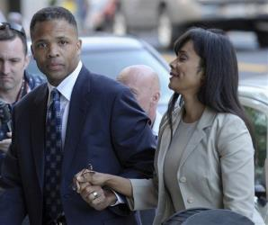 Jesse Jackson Jr. and his wife, Sandra, arrive at federal court in Washington, Wednesday, Aug. 14, 2013.