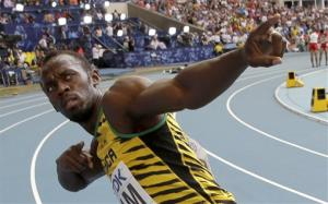 Jamaica's Usain Bolt celebrates winning his third gold medal in the men's 4x100-meter relay at the World Athletics Championships in the Luzhniki stadium in Moscow, Russia, Sunday, Aug. 18, 2013.