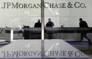 People stand in the lobby of JPMorgan Chase headquarters in New York.