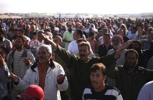 Syrian refugees chant slogans against Syrian President Bashar Assad at Zaatari Syrian refugee camp in Mafraq, Jordan.