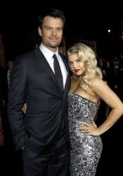 Josh Duhamel, left, and Fergie arrive at the premiere of New Year's Eve in Los Angeles on Monday, Dec. 5, 2011.