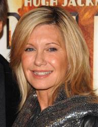 In this Nov. 24, 2008 file photo, Olivia Newton John attends the premiere of Australia at the Ziegfeld Theatre in New York.