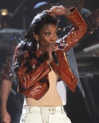 Brandy performs during the in memoriam for Whitney Houston at the BET Awards on Sunday, July 1, 2012, in Los Angeles.