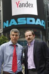 Ilya Segalovich, left, CTO of Yandex, and CEO Arkady Volozh pose for photos in front of the Nasdaq Market Site, in this May 24, 2011 file photo.