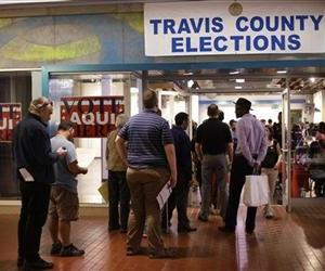 Voters wait in line at a polling place located inside a shopping mall, Tuesday, Nov. 6, 2012, in Austin, Texas.