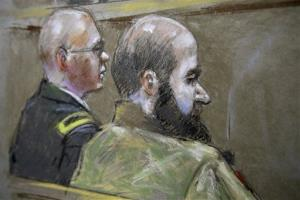 In this courtroom sketch of court proceedings, U.S. Army Maj. Nidal Malik Hasan, right, and defense attorney, Lt. Col. Kris Poppe, left, are shown Wednesday.