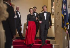 This film image released by The Weinstein Company shows Jane Fonda as Nancy Reagan, center left, and Alan Rickman as Ronald Reagan in a scene from 'The Butler.'