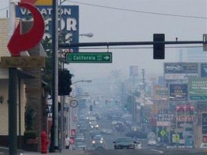 A smoky haze blankets Virginia Street headed south from the main downtown casino strip in Reno on Friday, the result of the Rim Fire.