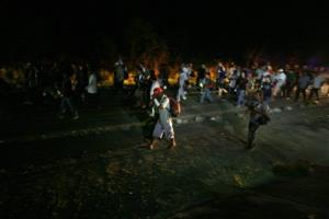 Migrants from Central America walk on the road leading from Arriaga, in the state of Chiapas, to Chahuites in Oaxaca state in 2011, after The Beast failed to arrive.