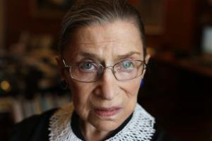 Associate Justice Ruth Bader Ginsburg poses for a photo in her chambers at the Supreme Court in Washington.