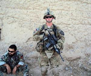 In this undated photo provided by the U.S. Army, Staff Sgt. Ty Carter poses for a photo in Afghanistan.