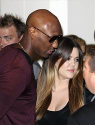 Khloe Kardashian and her husband Lamar Odom arrive for a launch of the Kardashian fashion accessory range at a department store in Sydney, Australia, Thursday, Nov. 3, 2011.