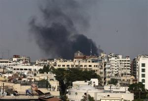 Black columns of smoke rise from heavy shelling in the Jobar neighborhood, east of Damascus, Syria, Sunday, Aug. 25, 2013.